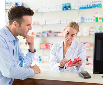 Chemist with customer